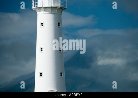 Cape Egmont Lighthouse and Mt Taranaki Mt Egmont Taranaki North Island New Zealand - Stock Photo