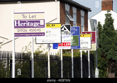 Multiple To Let and For Sale Signs outside Private Flats Warwick England - Stock Photo