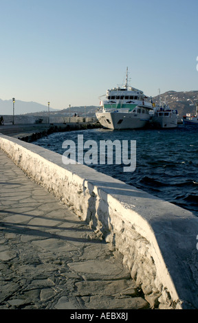 View along path beside a Ship in harbour Mykonos Island Greece - Stock Photo