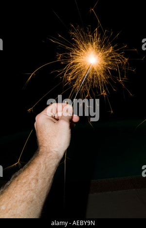 Hand Holding Sparkler On Fourth Of July Day Of Independence, USA - Stock Photo