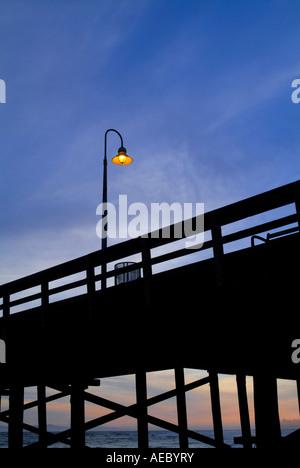 Ventura Pier With Lone Light Lamp Post At Sunset, Ventura California USA - Stock Photo