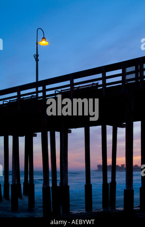 Ventura Pier With Lone Light Post Lamp At Sunset, Ventura California USA - Stock Photo