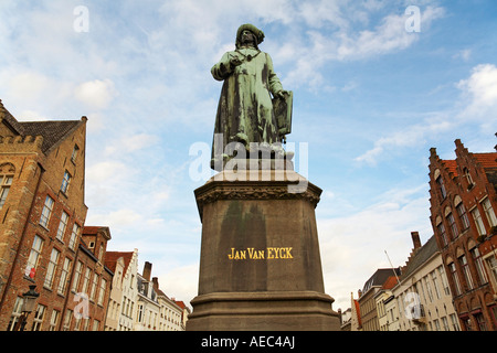 Statue of Jan Van Eyck 1390 1441 a flemish artist with typical buildings in background Bruges Belgium - Stock Photo