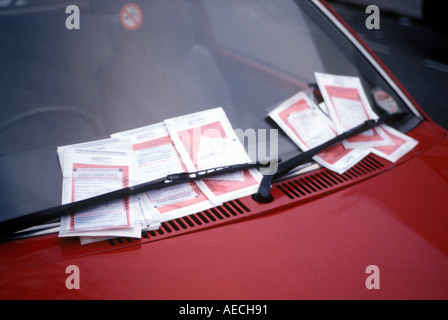 multiple parking ticket fines on a car windscreen - Stock Photo