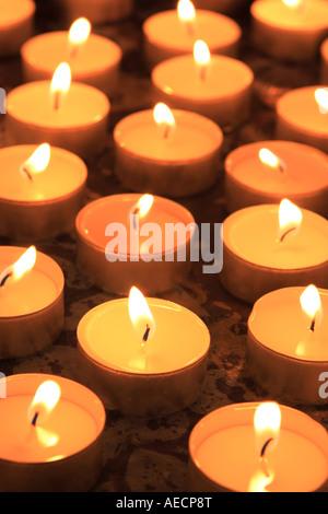 burning tea candle - Stock Photo