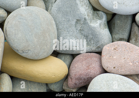 Round colored patterned stones in teh beach, Fair isle, Shetland ...