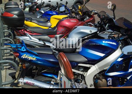 row of parked motorbikes - Stock Photo
