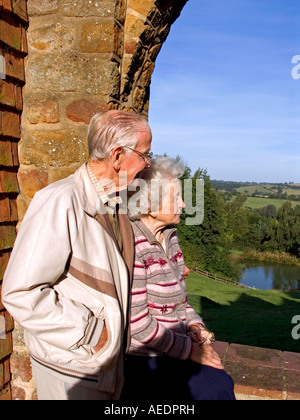 UK Oxfordshire Swerford elderly people looking out over landscape at Heath farm self catering holiday accommodation - Stock Photo