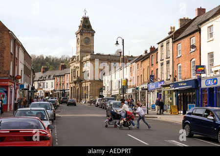 UK Wales Powys Welshpool mothers pushing prams across Broad Street near the Town Hall - Stock Photo