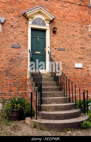 UK Wales Powys Montgomery Arthur Street tall steps to Old Stores House front door as flood prevention measure - Stock Photo