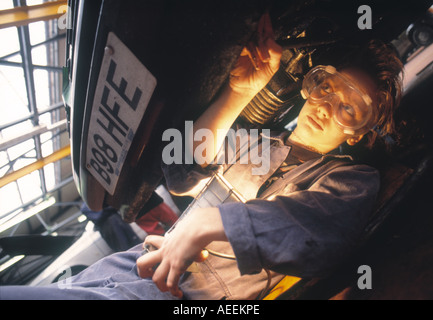 Credit line is mandatory John Angerson female cars motor mechanic course Girls at work in college environment - Stock Photo