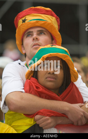 Two Ghanaian football fans viewing a world cup match with sad faces due to the defeat of the Ghanaian team - Stock Photo