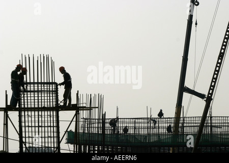 Shanghai China  - construction crew working on a raised section of new road for the new Formula 1 racing circuit - Stock Photo
