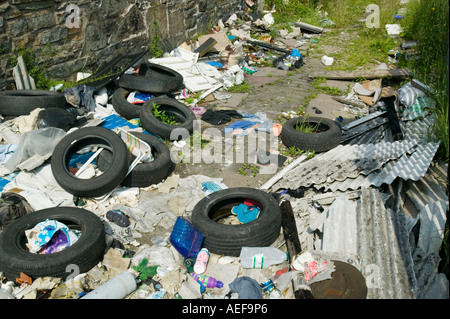 asbestos and other rubbish, illegally dumped in Blackburn, Lancashire, UK - Stock Photo