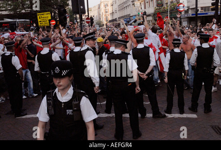 England fans taking to the streets of central London confronting police after loosing match of English World cup - Stock Photo
