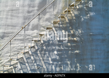 Metal Stairs On Old Rusty Bumpy White Stucco Curved Wall, USA - Stock Photo