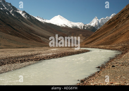 A wide view of snow-clad mountains over spiti river standing tall, Kaza Himachal Pradesh India - Stock Photo