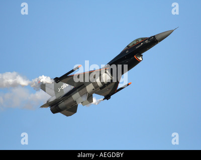 Royal Netherlands Air Force F-16 jet fighter flying nose up during an air display - Stock Photo