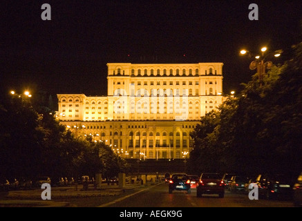 The Parliament Palace at night Bucharest, tree and fountain lined Union Avenue, Romania, Europe, EU - Stock Photo