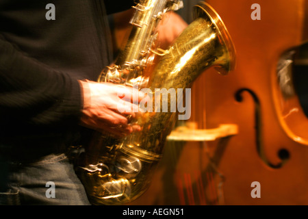 Blur of saxophone and upright bass  - Stock Photo
