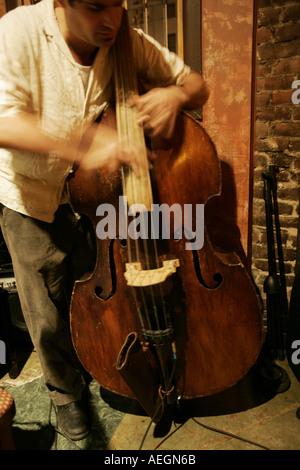 Musician playing upright bass  - Stock Photo