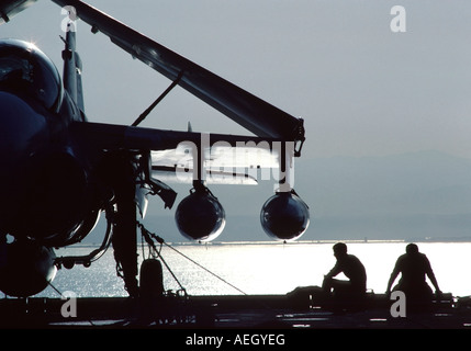 Two Sailors on the flight deck of the American aircraft carrier, USS Carl Vinson. - Stock Photo