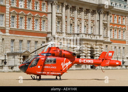 Horizontal close up of London's Air Ambulance landed to attend an emergency in central London - Stock Photo