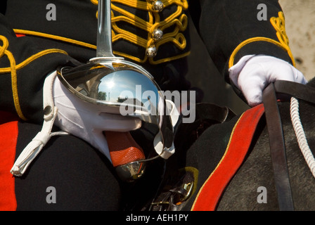 Horizontal close up of a sword and uniform of the Household Cavalry mounted sentries on guard outside Horse Guards - Stock Photo