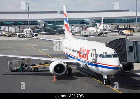 A Czech Airlines jet is being loaded with the passengers luggage on the Praha Ruzyne International Airport in the - Stock Photo