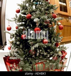 Christmas tree, shop window, Manchester England - Stock Photo