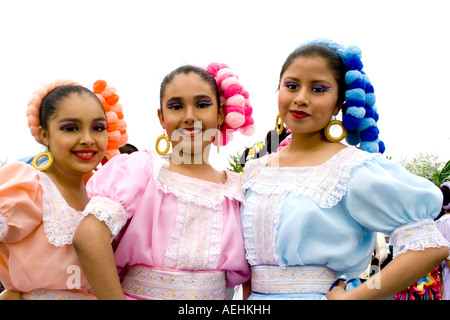 Three gorgeous Chicana woman ready to march in the parade. Cinco de Mayo Fiesta. 'St Paul' Minnesota USA - Stock Photo