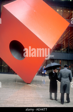 Isamu Noguchi's Red Cube sculpture located in front of 140 Broadway, between Liberty and Cedar Streets - Stock Photo