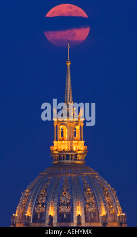 Paris France close up view of Invalides dome and full moon at moonrise - Stock Photo