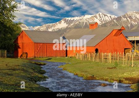 Farmland near Joseph with barn stream and horse Oregon - Stock Photo