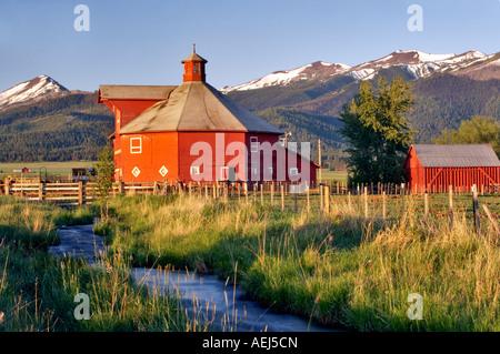 Farmland near Joseph with barn and stream Oregon - Stock Photo