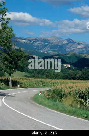 curving road through the beautiful Le  Marche countryside in Italy - Stock Photo