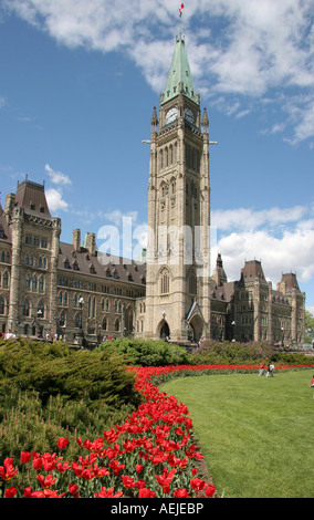 Peace Tower with tulips in Canada Ontario Ottawa Capital of Canada Government of Canada Parliament Building - Stock Photo