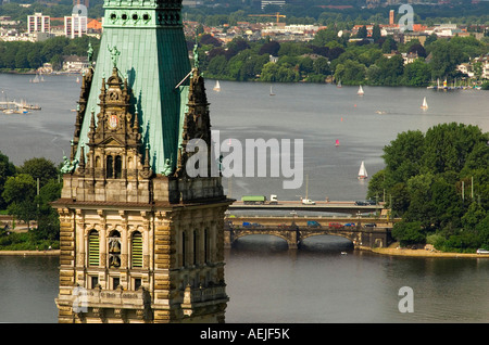 The tower of Hamburg City Hall in front of lake Alster, Hamburg, Germany - Stock Photo