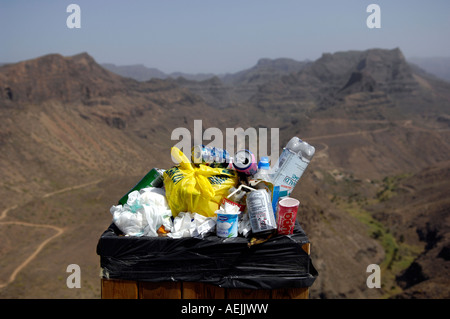 Crammed trash can in nature reserve, Gran Canaria, Canaries, Spain - Stock Photo