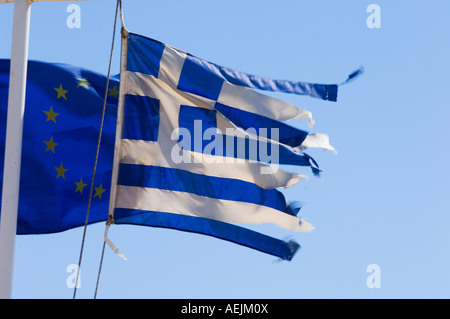 Greek Flag and European Flagg, wind-blown, Greece - Stock Photo