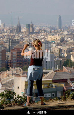 Cityscape from the Montjuic, tourist takes a photo, Barcelona, Catalonia, Spain - Stock Photo