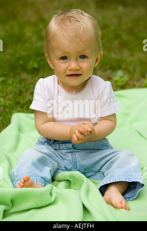 A 10 month old baby girl playing - Stock Photo