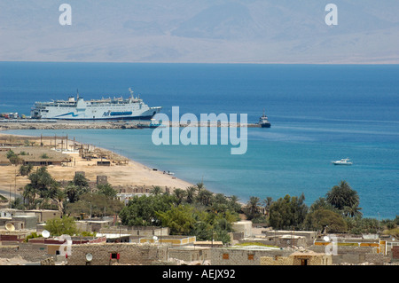 Ferry boat from Aqaba operated by AB (Arab Bridge) Maritime anchored in the bay of Nuweiba or Nueiba a coastal town - Stock Photo
