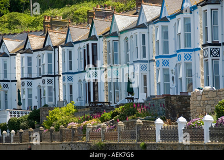 Porthleven semidetached houses in long curved terrace overlooking harbour many used as guest houses Cornwall England UK