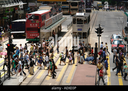 Pedestrians crossing zebra cross in Central district Hong Kong China - Stock Photo