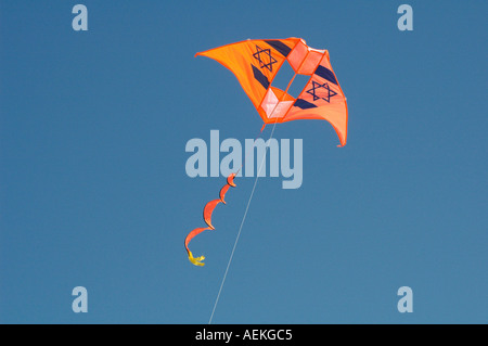 Kite with Star of David Jewish symbol flying in the sky - Stock Photo