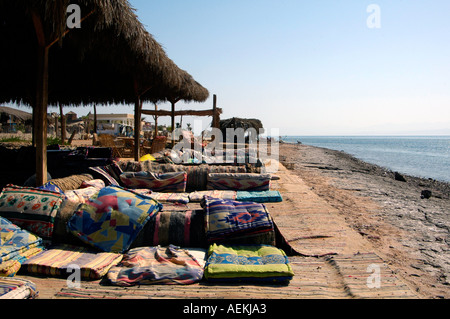 Sun loungers in Nuweiba Tarabin beach in Nuweiba also spelled: Nueiba a coastal town in the eastern part of Sinai - Stock Photo