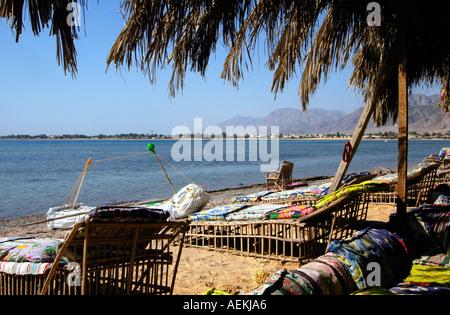 Sun loungers in Nuweiba Tarabin beach in Nuweiba also spelled: Nueiba a coastal town in the eastern part of Sinai - Stock Photo