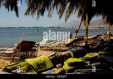 sun loungers in Sun loungers in Nuweiba Tarabin beach in Nuweiba also spelled: Nueiba a coastal town in the eastern - Stock Photo