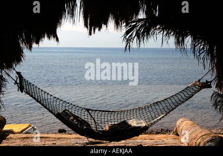 A hammock in Nuweiba Tarabin beach in Nuweiba also spelled: Nueiba a coastal town in the eastern part of Sinai Peninsula, - Stock Photo